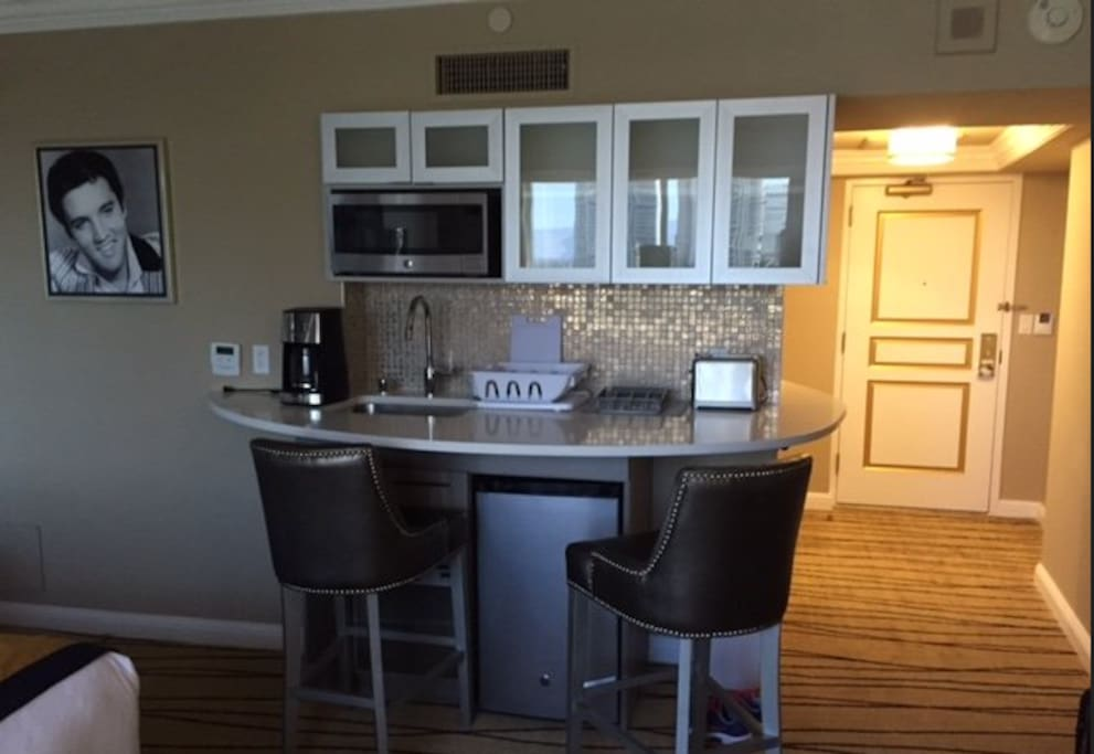 Wet bar with mini fridge and built-in microwave