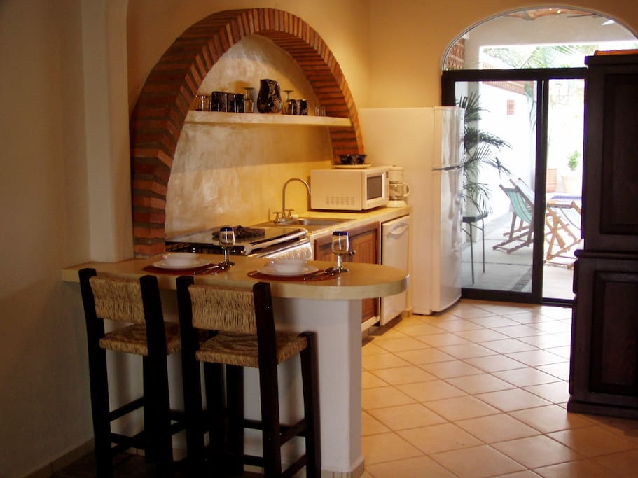 Kitchen and breakfast bar - opens to terrace dining area, fountain & pool