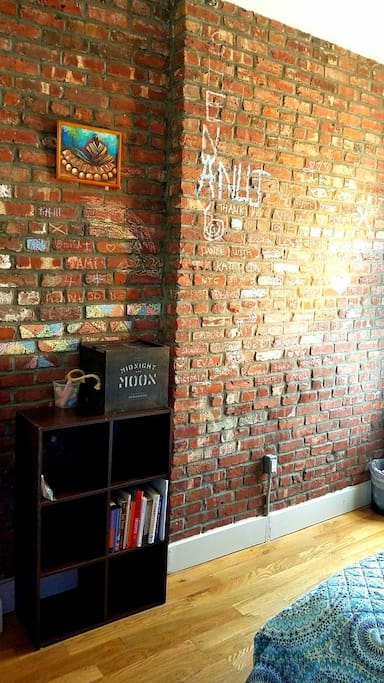 "The red brick wall, chalked by our guests! And special surprises for ""honeymooners"" in the ""Moon"" box.  :-)"