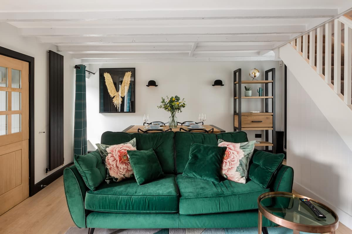 Sink into the Emerald Velvet Sofa at an Intimate Hideaway