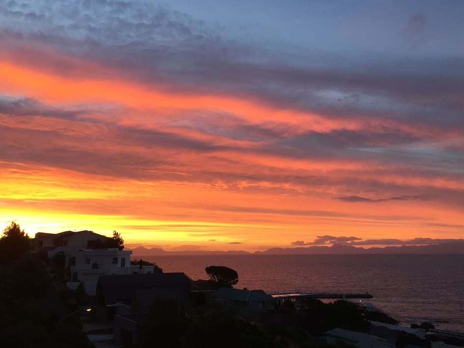 Evening sunset over False bay, with Table mountain in the background.