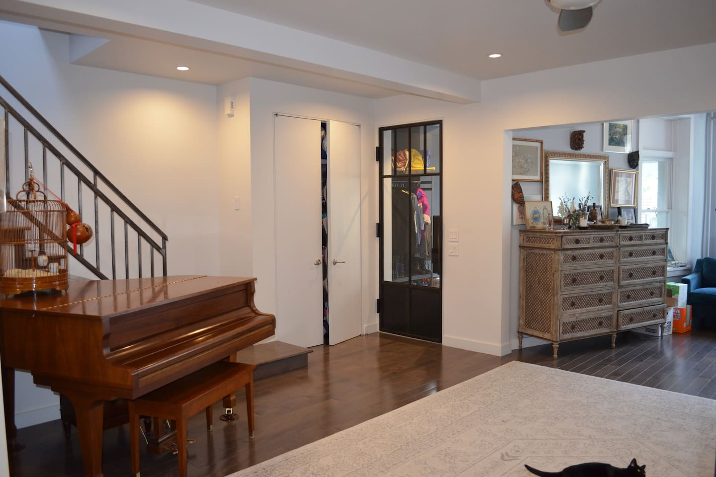 Entryway into our home, stairs to bedrooms & baby grand piano.