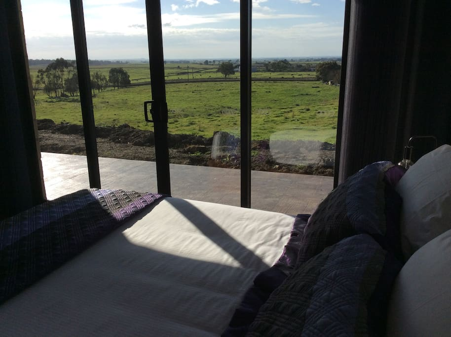 Large sunny comfortable bedroom with views.