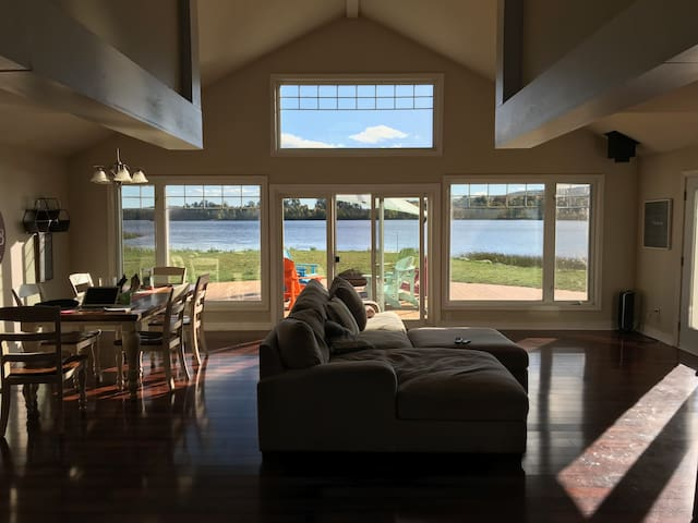 Main living and dining area looking towards deck and lake
