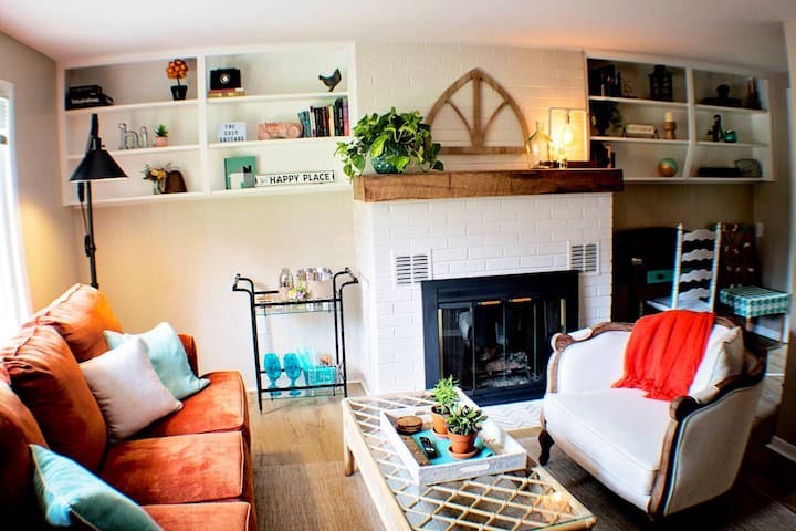 Cozy living room with pull out couch and desk