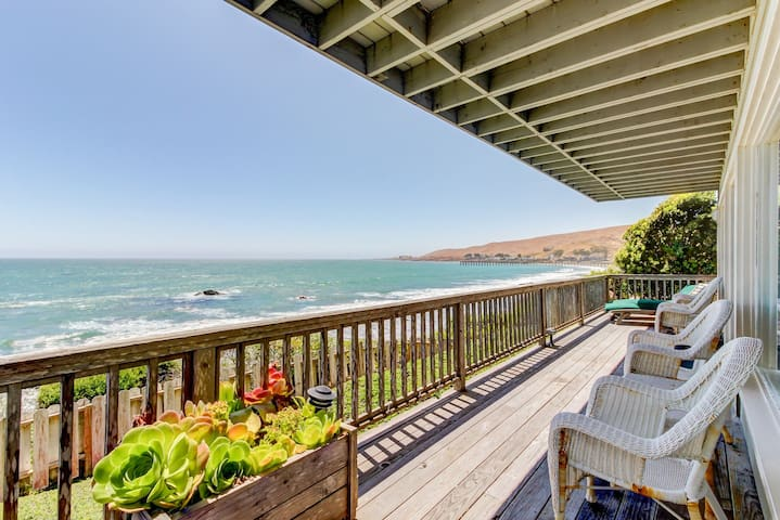 Watch for dolphins and whales from this oceanfront rental w/ fireplace & deck