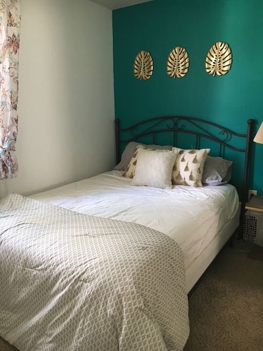 Your private bedroom- complete with linens and towels for your needs and a window AC unit. You are located on the 2nd floor of the house. There are 3 other bedrooms as well as the full bathroom on this floor