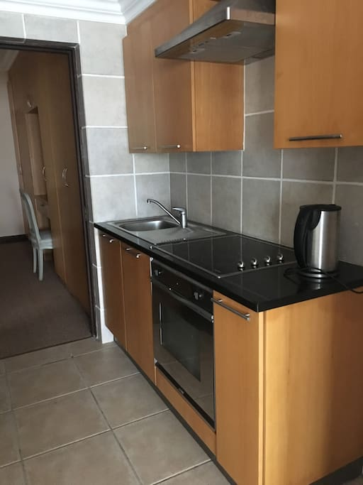 Full kitchenette with stove