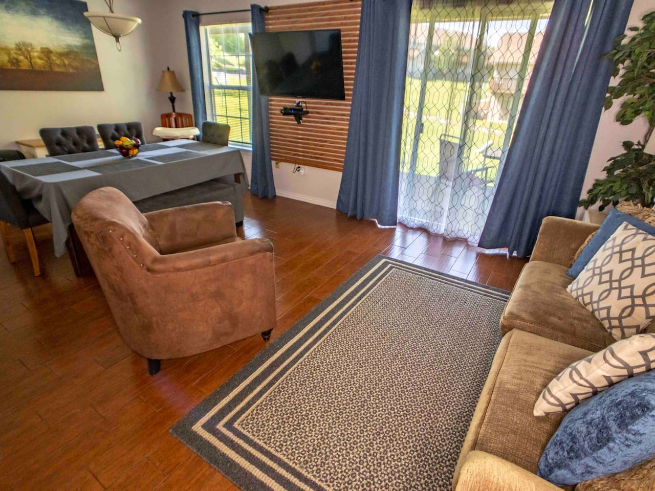 """Family room with 50"""" HDTV, two patios with outdoor dining, new furniture, and Wi-Fi."""