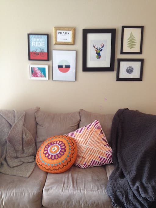 Artwork on top of a very big and comfy couch