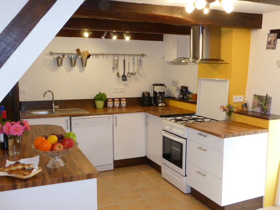 New modern fully equipped kitchen with fridge-freezer, cooker, dishwasher, microwave, toaster, kettle and filter coffee machine.