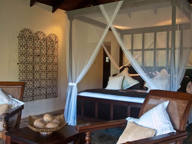 Four poster king sized bed in the upper guest rooms.