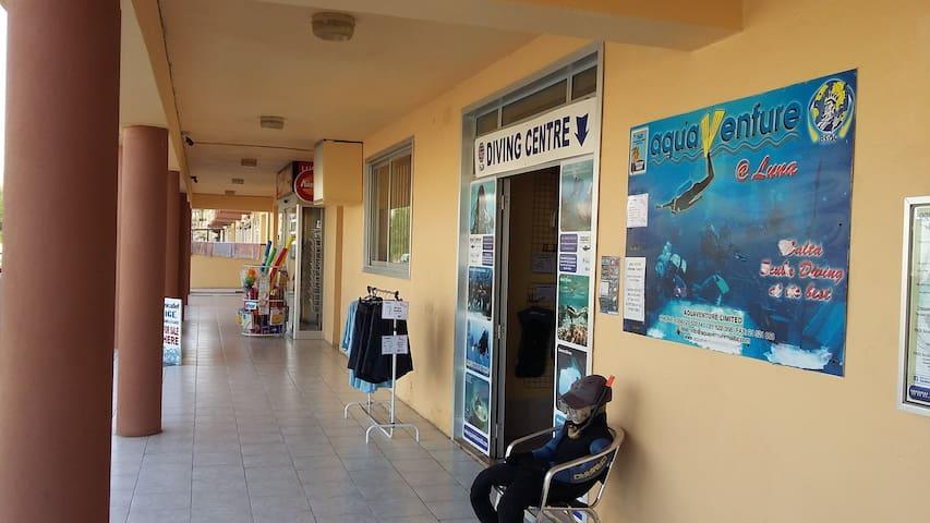 Luna minimarket + Padi diving centre very close to house.