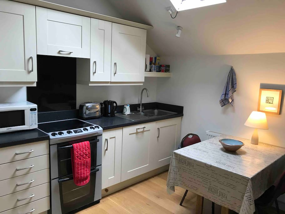 The fully fitted kitchen and dining area.