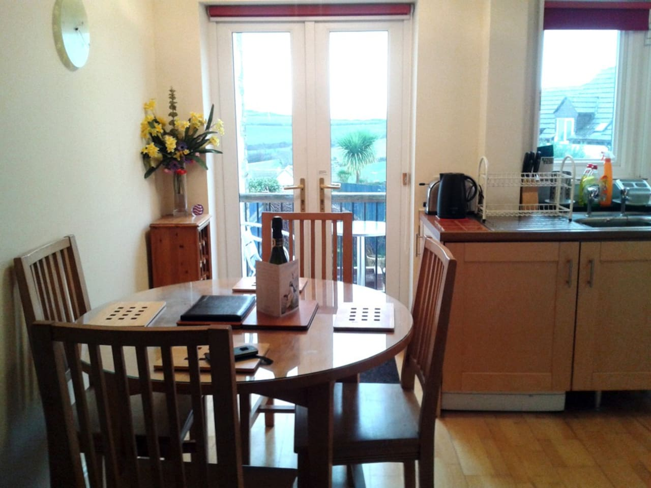 Kitchen/Dinner Looking with outside Balcony view to Downs