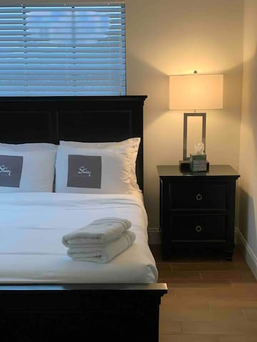 Bedroom 2. Full Bed Upstairs  Shared Bathroom  Bedside table &  lamp that has an electrical outlet & USB outlet. Hangers/Closet
