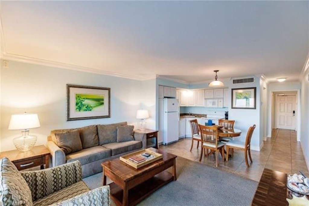 Spacious living room with all the amenities including Amazon Alexa, Roku, Sleeper Sofa overlooking the ocean, full kitchen, and more.