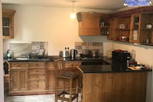 Hand Crafted Pine Kitchen, Oven, Gas Hob, Microwave, Cutlery and cooking utensils all supplied.