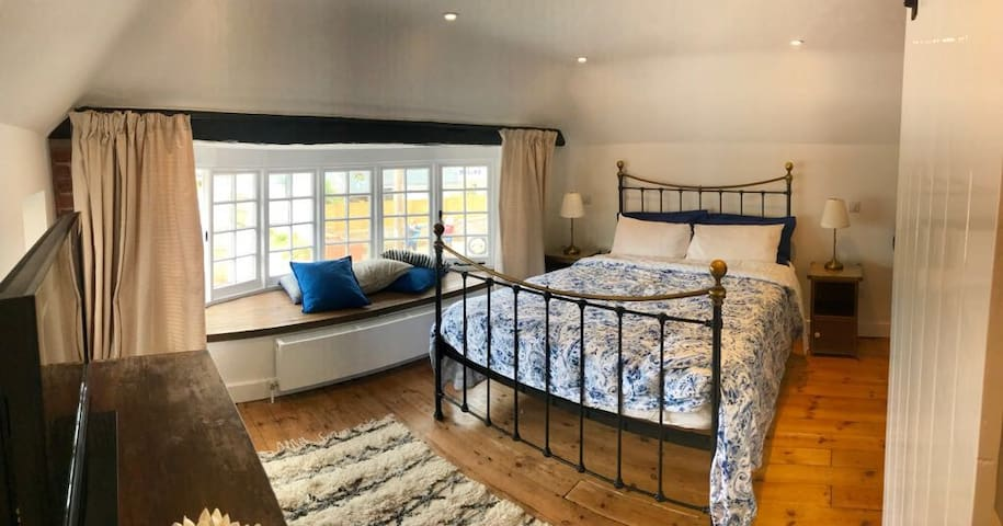 The Master Bedroom has a Large bay window with sea views