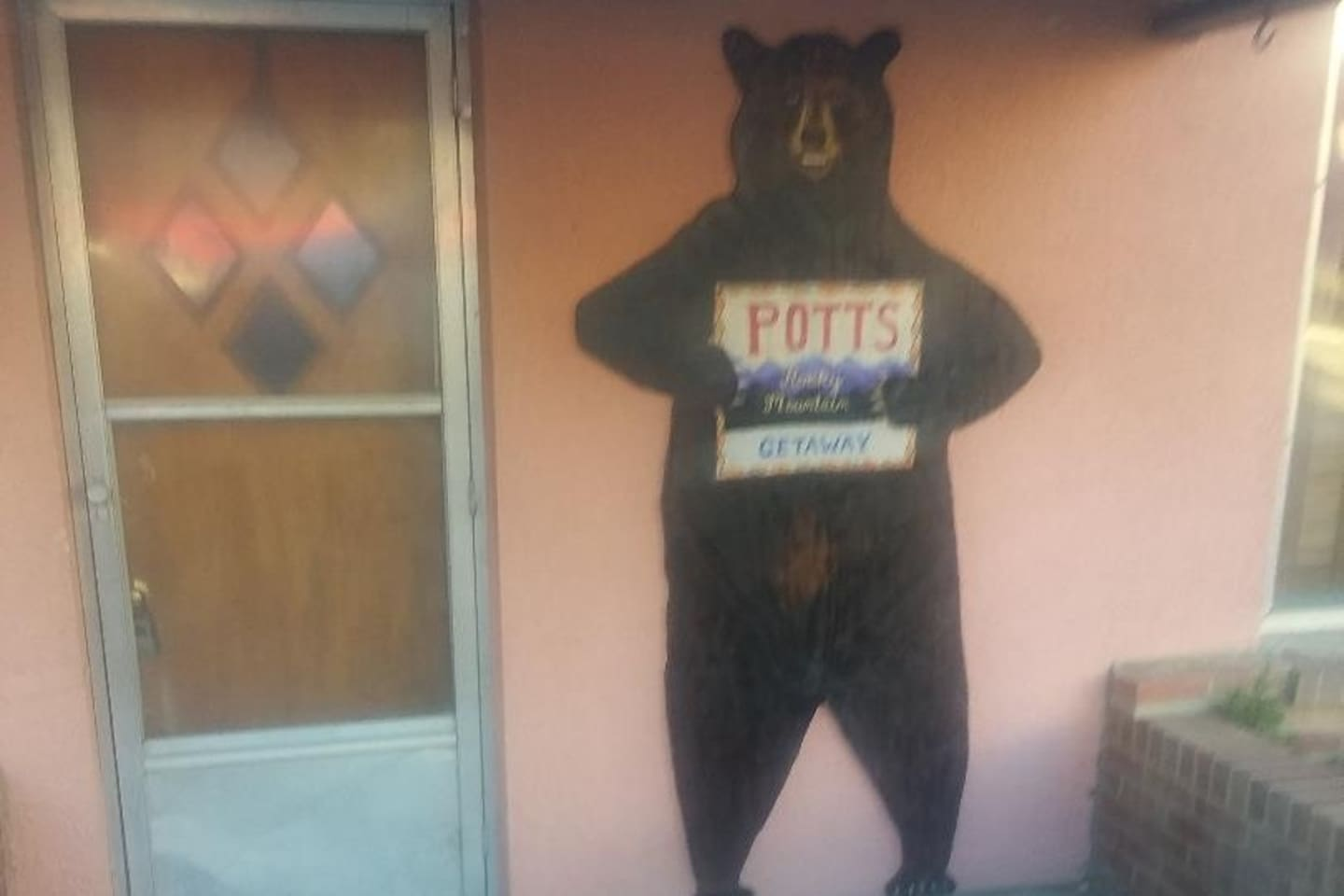 Rocky the Bear welcomes you to Potts Rocky Mountain Getaway