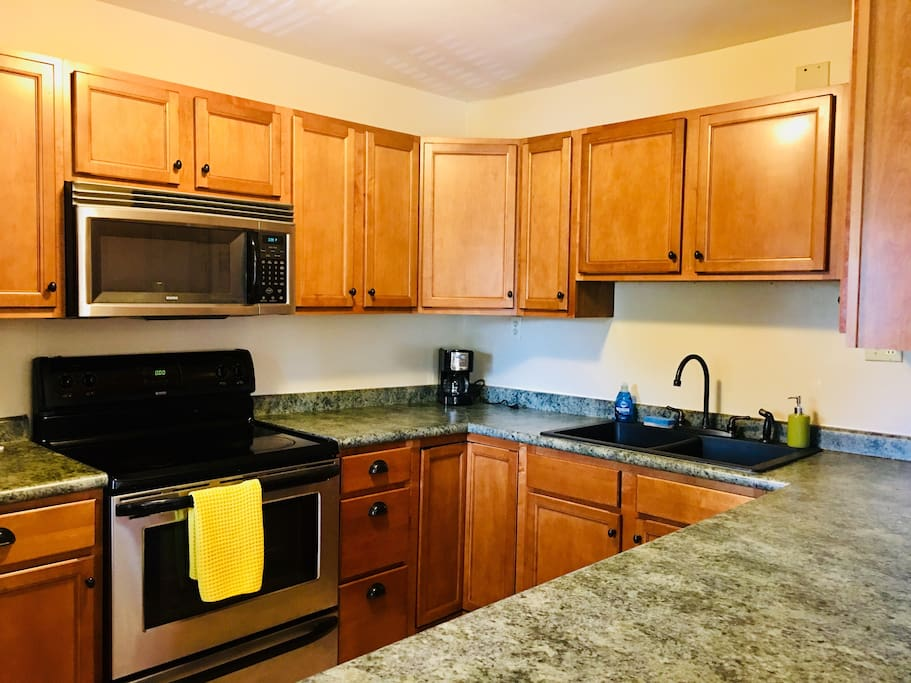 Updated and spacious kitchen with stainless steel appliances , and plenty of storage.
