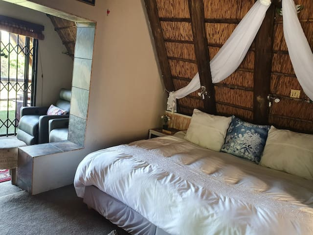 Main bedroom with private tv room and private patio