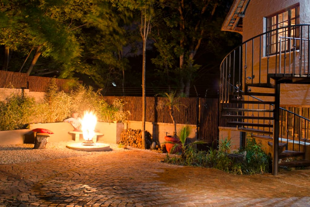 Private garden with fire and BBQ area.