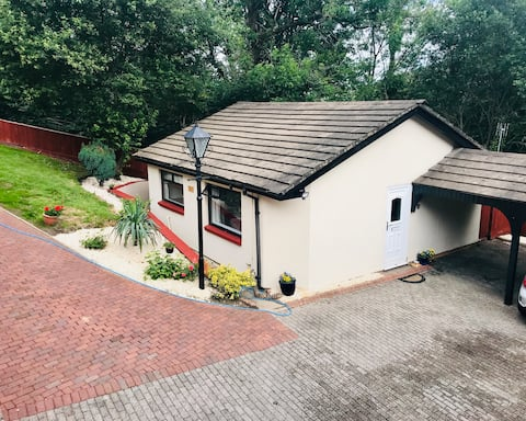 Self contained, two bedroomed home, w/parking.