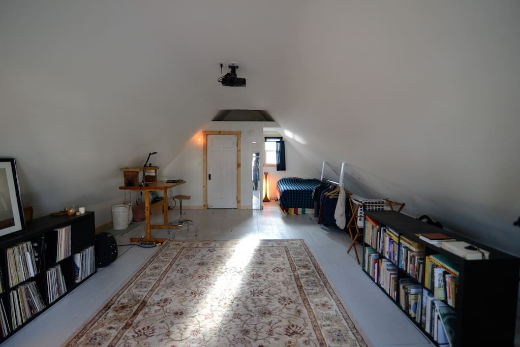 This is The Loft. It has plenty of natural light in the morning and afternoon. The space is grand and it's all yours.