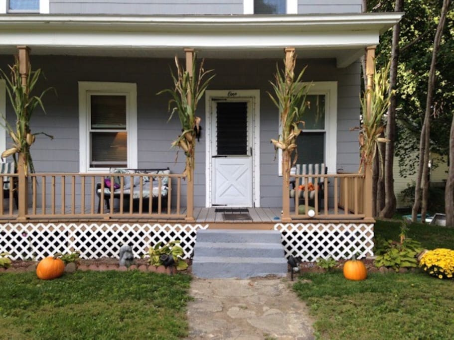 Front of the house with lovely, relaxing porch (fall).