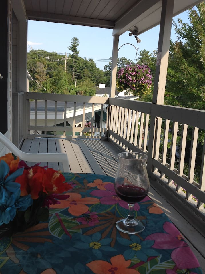 Enjoy the porch and the lovely view of the grounds.