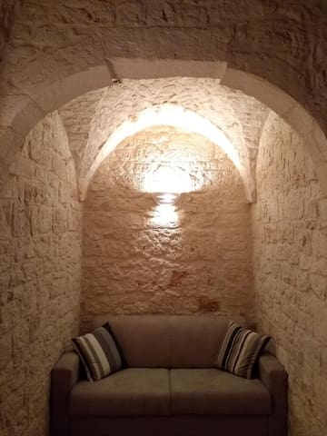 A close up view of the stone alcove with the sofa b