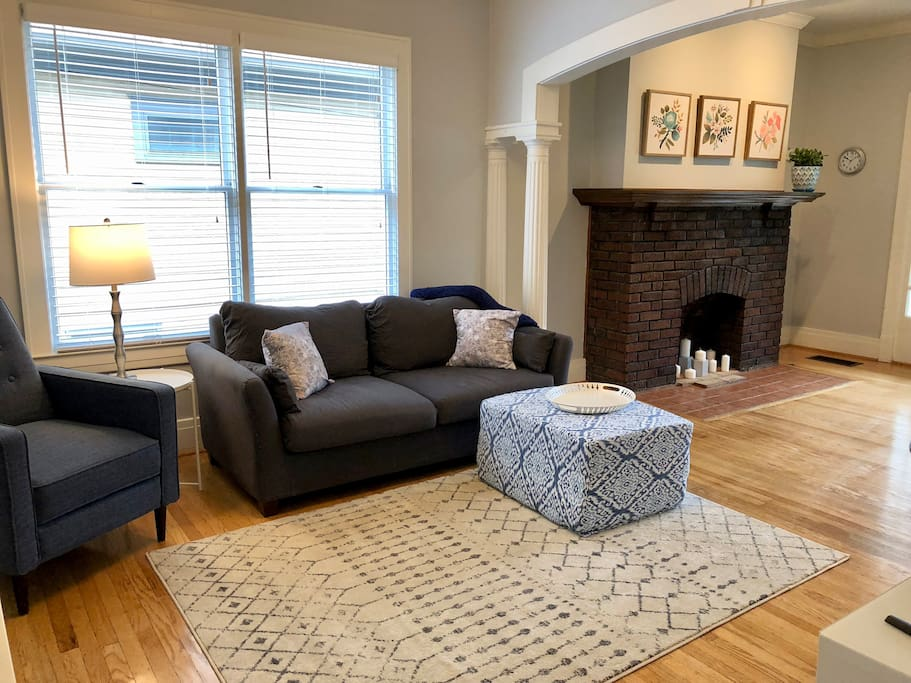 Wide open living room with plenty of seating and charm.