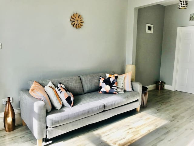 Large open plan living-area with comfortable sofa bed for 2 guests