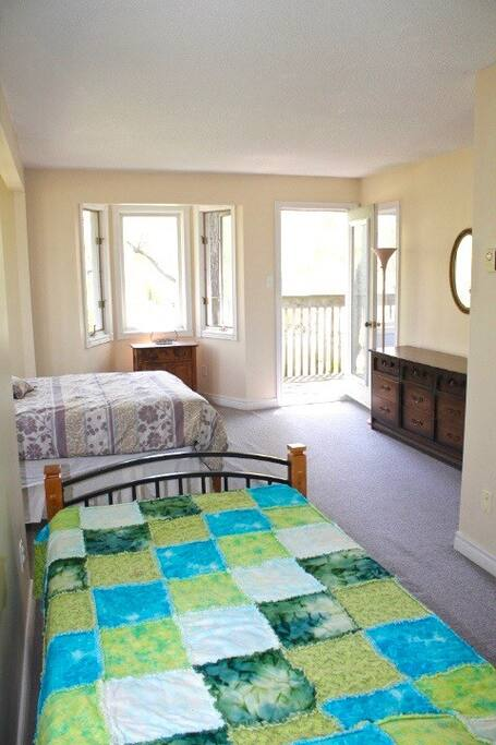 Double bed and single bed room with lake view