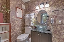 The bathroom has been newly remodeled with a jetted tub, new cabinet, and mirror