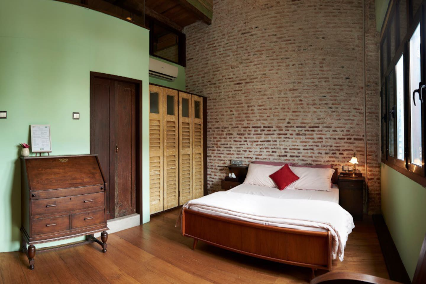Situated at the north end of the building .  1 mid-century style queen sized teak bed . En-suite bathroom with rain shower .