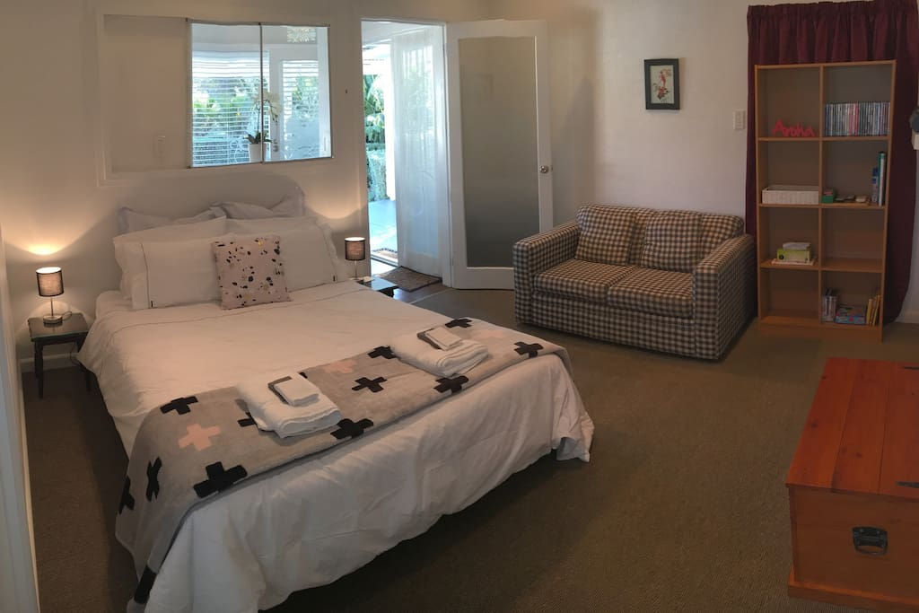 The main bedroom with sofa and heat pump.