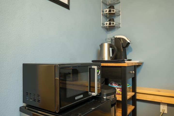 Microwave, mini-fridge, Keurig Coffee Maker, hot-water kettle,  silverware, all for your use
