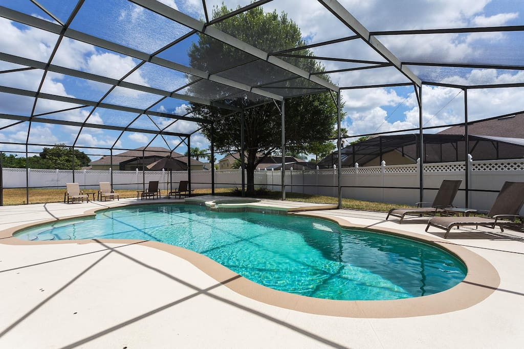 East-facing pool with spillover spa, luxury slingback patio furniture, barbecue grill and more