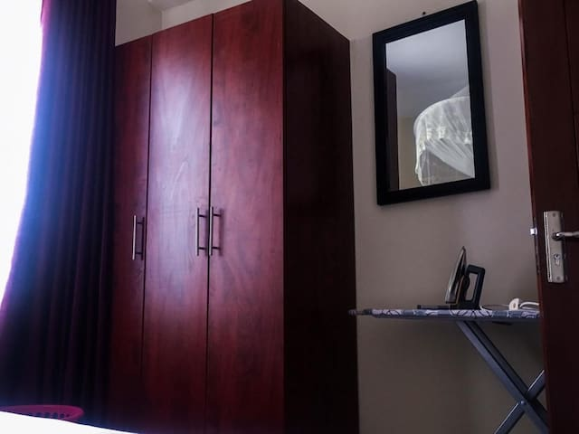 bedroom with wardrobe and ironing board