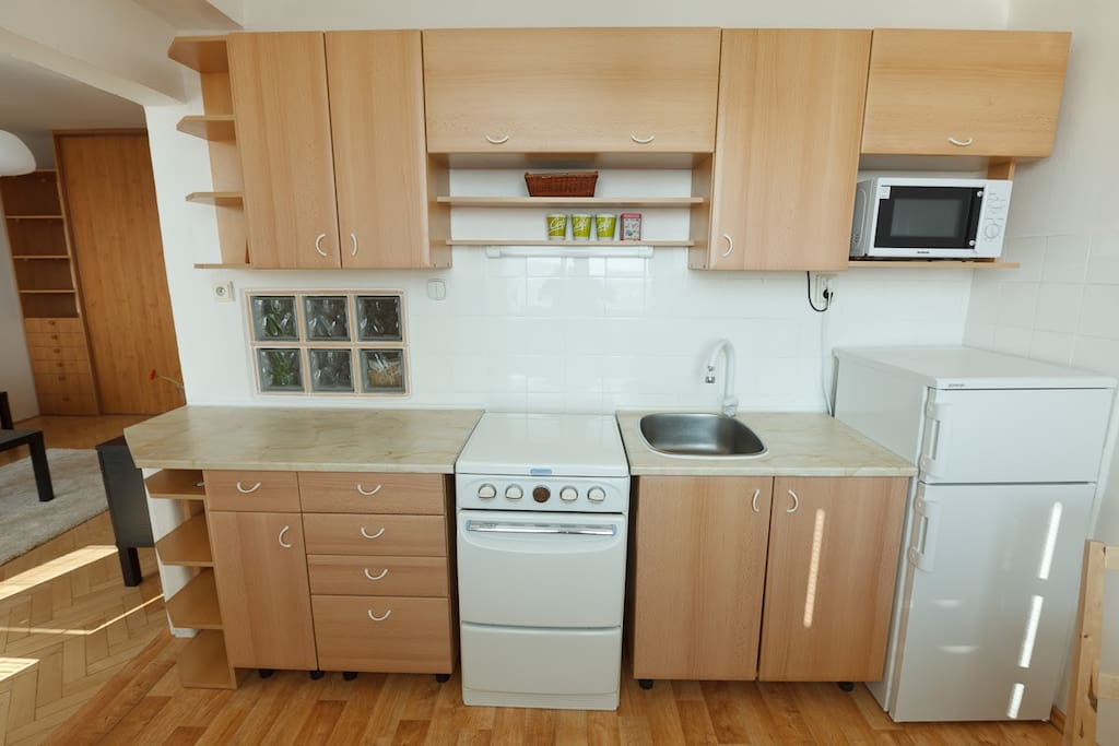 Kitchen with cooker, fridge, microwave and kettle