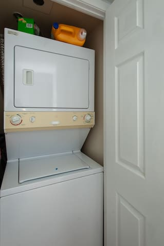 Washer & dryer with laundry detergent and dryer sheets.