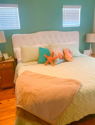 """This room features a King Pillow Top bed with a 40"""" TV"""
