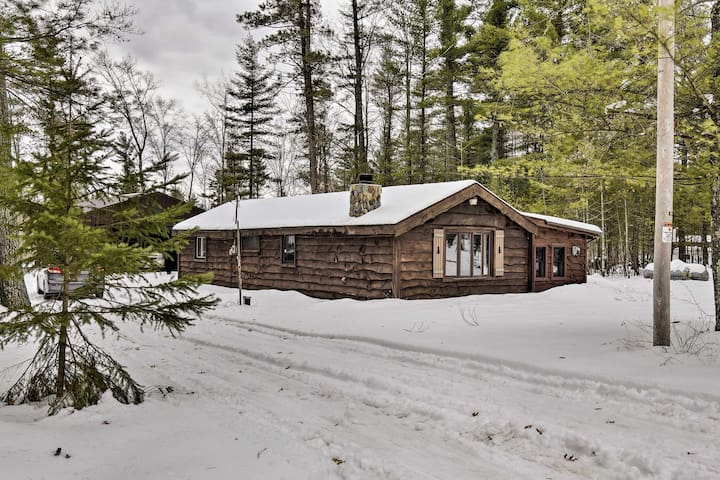 This charming Pound vacation rental is tucked away in the woods.