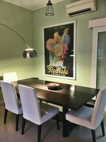 Dining Space Featuring Original Art from France