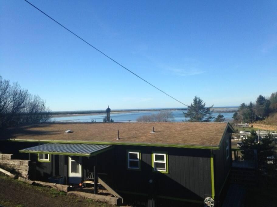 Street view of house and bay. Modern Scandinavian color scheme