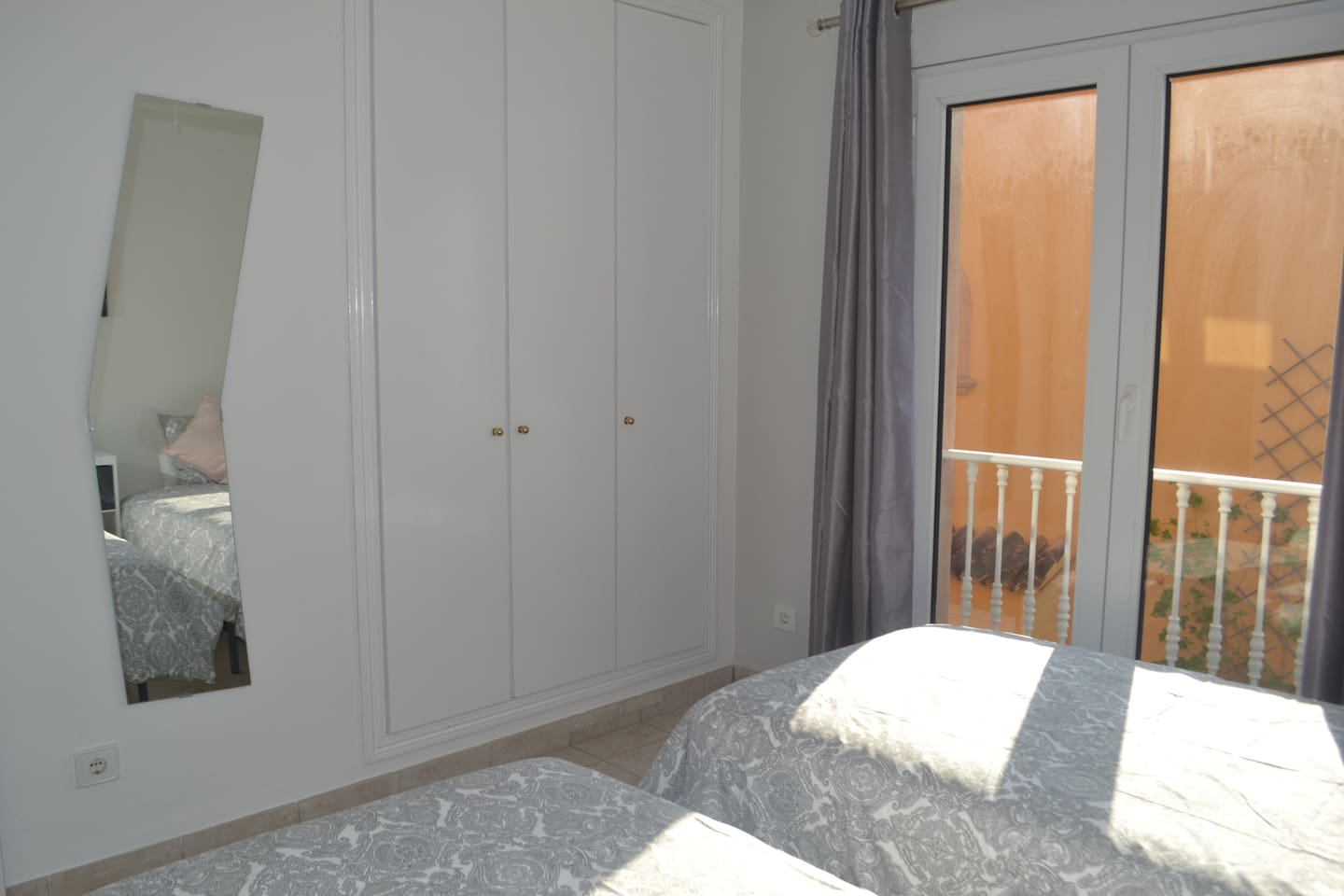 bedroom 2 with 3 wardrobes and twin beds