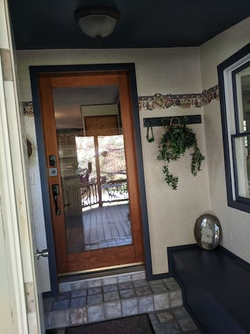 Open front door into entryway.  Electronic key on glass door.
