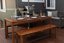 The back deck has lots of room for family and friends to share stories over a meal cooked on the BBQ